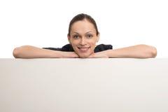 Beautiful woman above white blank billboard Royalty Free Stock Image