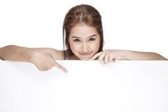 Beautiful woman above white blank billboard Stock Photos