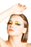 Beautiful woman with abstract make up. Stock Photos