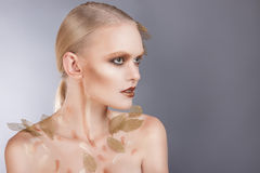 Beautiful  woman in accessories with gold leaves Royalty Free Stock Images
