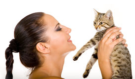 Beautiful woman with adorable kitten Royalty Free Stock Images