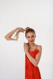 Beautiful woman advertises Royalty Free Stock Photography