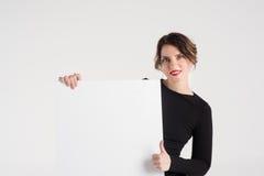 Beautiful woman advertises Stock Image