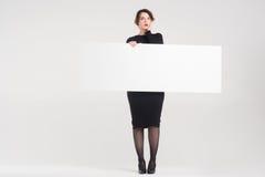 Beautiful woman advertises Stock Photo