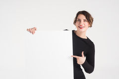 Beautiful woman advertises Royalty Free Stock Images