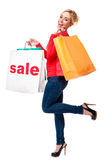 Beautiful Woman Advertising Sale Shopping Bag. Beautiful Young Woman Carrying Shopping Bag Advertising Sale Sign Smiling Isolated on White Stock Photography