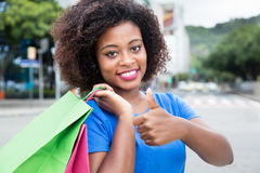 Beautiful woman from Africa likes shopping Stock Photos