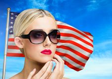 beautiful woman against american flag royalty free stock image
