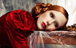 Beautiful woman against autumn decoration. Fashion Royalty Free Stock Photo