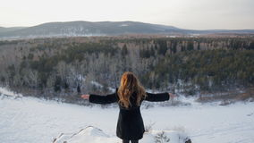 Beautiful woman against background of snow covered nature, rear view stock video footage