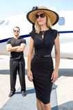 Beautiful Woman Against Bodyguard And Private Jet Stock Image