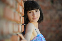 Beautiful woman against a brick wall Royalty Free Stock Image