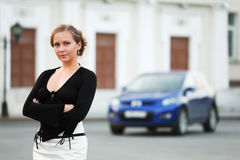 Beautiful woman against a car Royalty Free Stock Photography