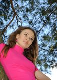 Beautiful woman against a limb of a tree Stock Photography