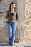 Beautiful woman against stone wall Royalty Free Stock Photos