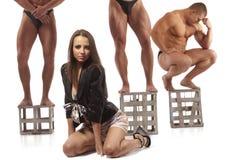 Beautiful woman against three athletes Royalty Free Stock Photos