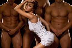 Beautiful woman against three athletes Royalty Free Stock Image