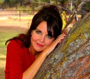 Beautiful woman against tree Royalty Free Stock Photo