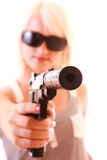 Beautiful woman aiming with gun isolated Stock Photography