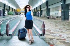 Beautiful woman on the airport Stock Photos