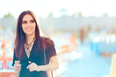 Beautiful Woman in All Black Outfit Attending Outdoor Party Royalty Free Stock Photography