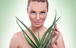 Beautiful woman with aloe Royalty Free Stock Images