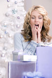 A beautiful woman amazed at christmas Royalty Free Stock Image