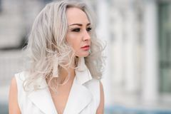 Woman with long hair in amazing clothes. Beautiful woman in amazing clothes posing in hotel royalty free stock photo