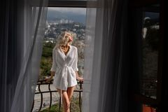 Woman with long hair in amazing clothes. Beautiful woman in amazing clothes posing in hotel stock images