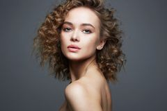 Beautiful woman. amazing curly girl with make-up royalty free stock photo