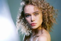 Beautiful woman. amazing curly girl with make-up royalty free stock photography
