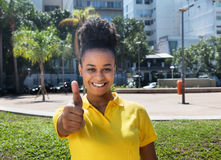 Beautiful woman with amazing hairstyle showing thumb up Stock Photos
