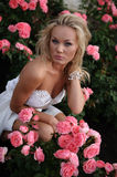 Beautiful Woman Amogst Roses Royalty Free Stock Photos