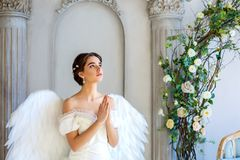 Beautiful woman with angel wings inspires beauty royalty free stock photo
