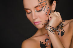 Beautiful woman with animal face art and spines Stock Images