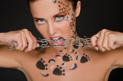 Beautiful woman with animal pictures bite collar Stock Images