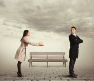Beautiful woman apologizing to man. Beautiful women apologizing to men at outdoor Stock Image
