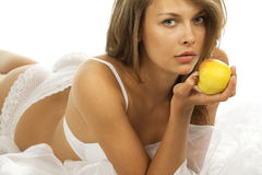 Beautiful woman with an apple Stock Image