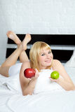Beautiful woman with apple Stock Photography