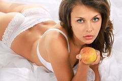 Beautiful woman with an apple Royalty Free Stock Photography