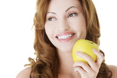Beautiful woman with apple Stock Photos
