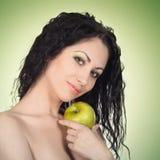 Beautiful woman with apple Stock Photos