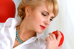 Beautiful woman with an apple in her hand Royalty Free Stock Images