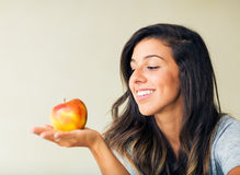 Beautiful woman with an apple Stock Photo