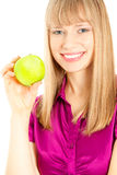 Beautiful woman with apple smiling Royalty Free Stock Photography