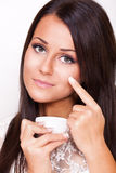 Beautiful woman applied face cream Stock Image
