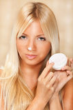 Beautiful woman applied face cream Royalty Free Stock Photos