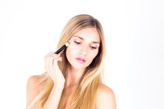 Beautiful woman apply foundation on the face tone Stock Photography