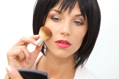 Beautiful Woman Applying Blush Royalty Free Stock Photography