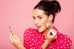 Beautiful Woman Applying Blusher Stock Photo